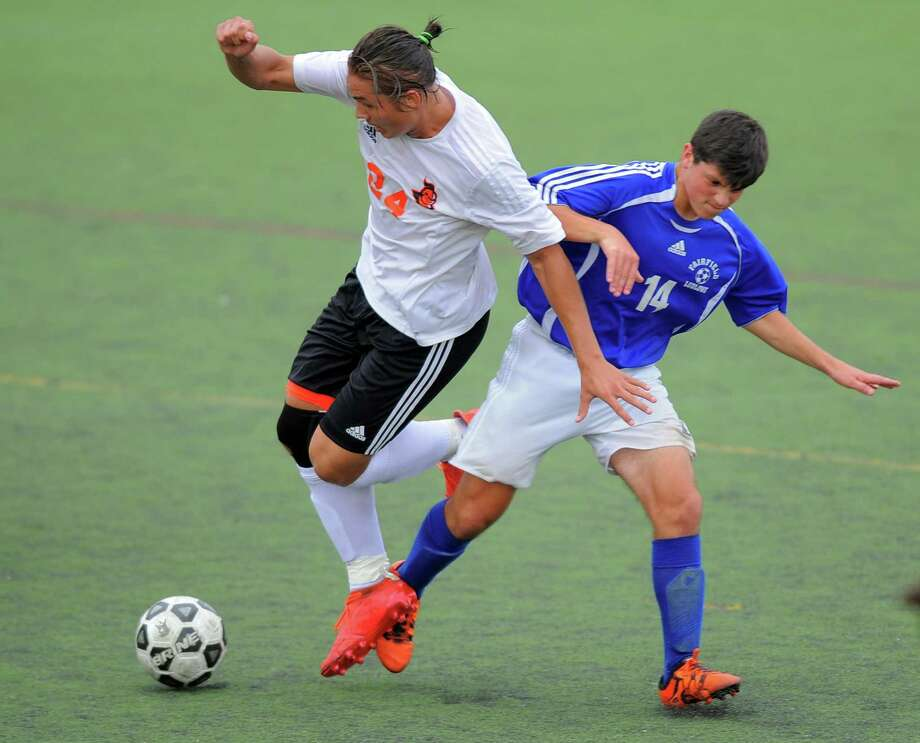 Stamford Partyk Tomczak and Fairfield Ludlowe Max Goldring battle for the ball in the second half of a boys varsity soccer game in Stamford on Sept.9, 2016. Fairfield Ludlowe defeated Stamford 2-1. Photo: Matthew Brown / Hearst Connecticut Media / Stamford Advocate