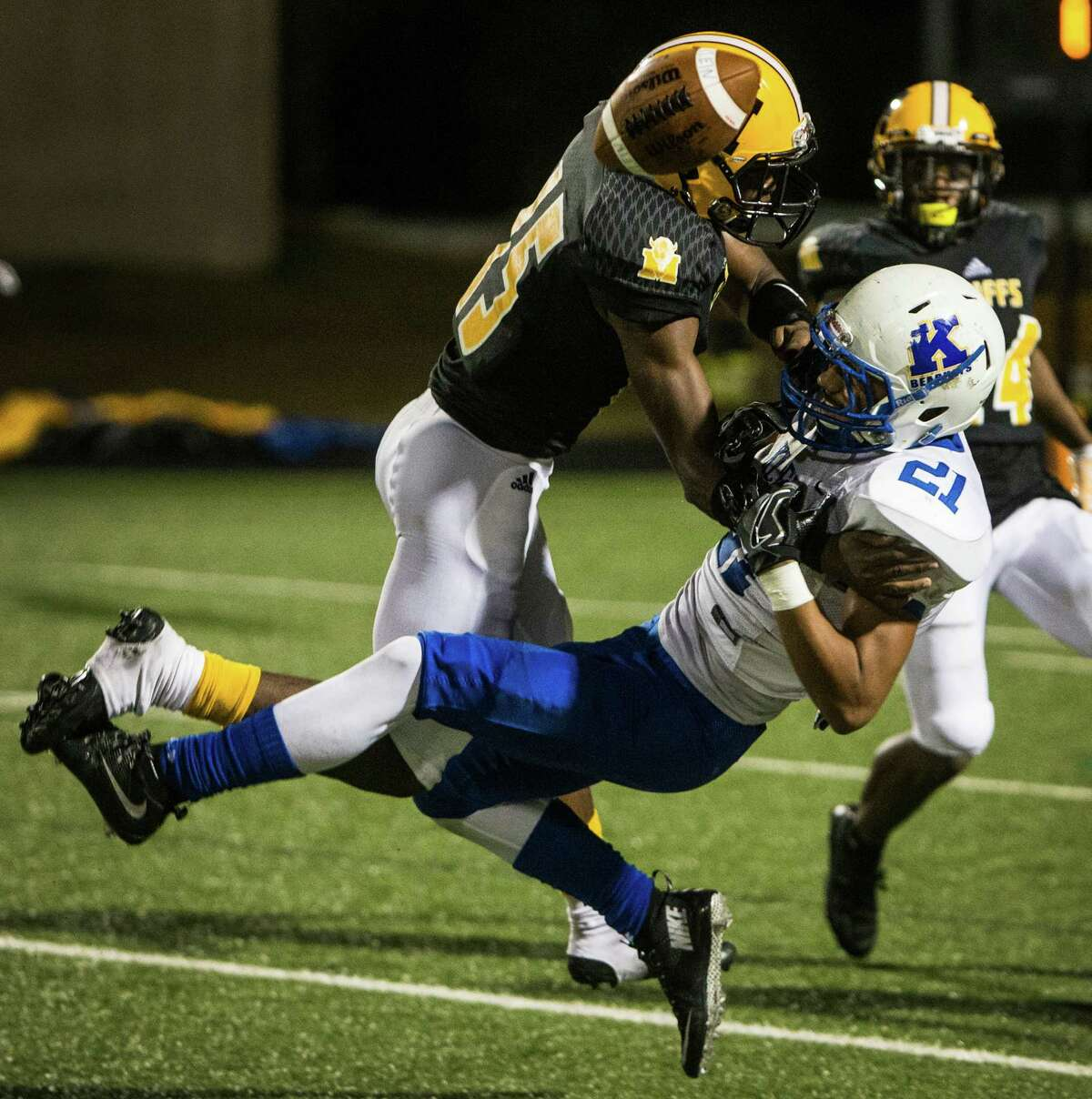 Fort Bend Marshall defensive back Brandon Brantley (15) breaks up a pass intended for Klein running back Malcolm Deary (21) during the fourth quarter of a non-district high school football game at Hall Stadium on Thursday, Sept. 8, 2016, in Missouri City.