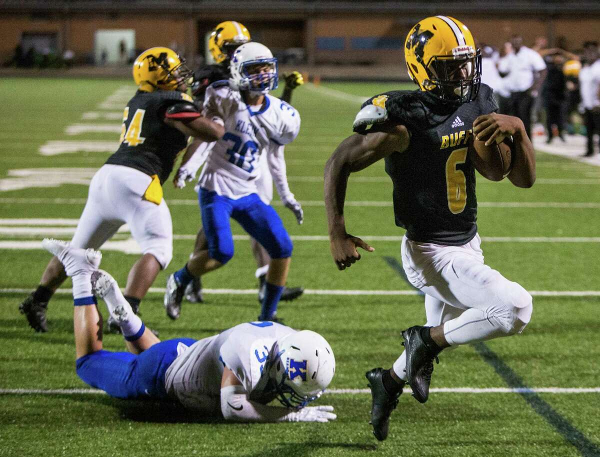 Fort Bend Marshall running back Antonio Brooks (6) runs past Klein linebacker Javon Roashe (32) for a 5-yard touchdown run, setting up a game-winning 2-point conversion, in overtime of a non-district high school football game at Hall Stadium on Thursday, Sept. 8, 2016, in Missouri City. Marshall beat Klein 32-31.