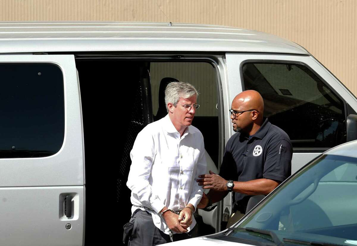 Charles Banks is transported to federal court after he turned himself in on federal wire fraud charges alleging that he misled Tim Duncan into making certain investments.