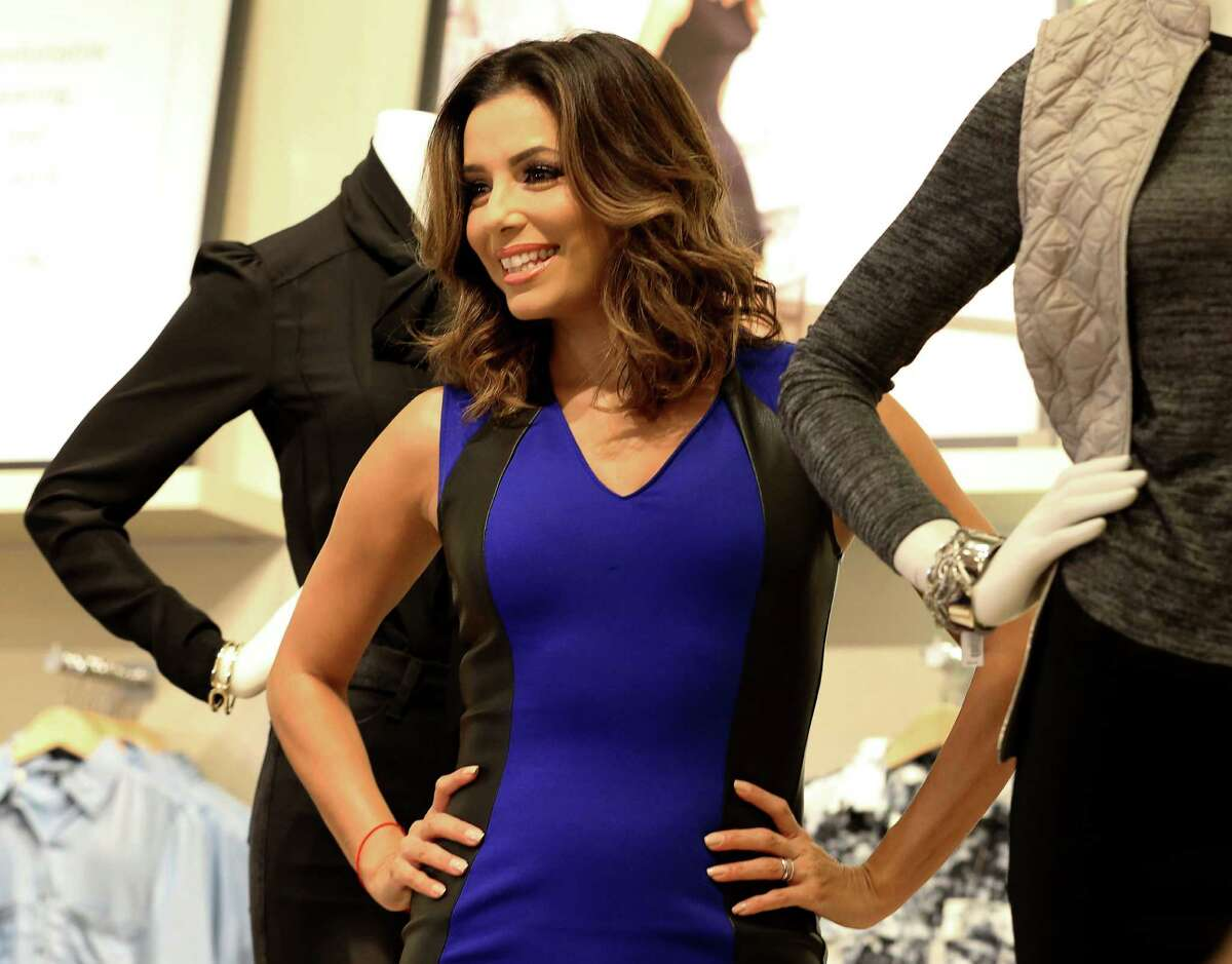 Actress Eva Longoria shows her new fashion line at The Limited at the Galleria on Friday.