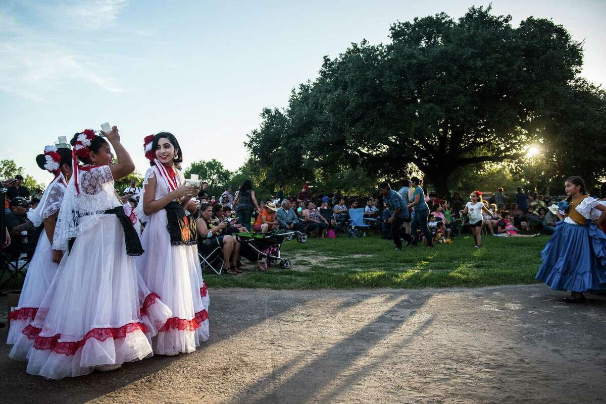 Malia Cox, 12, third left, leads members of San Antonio's Parks and Recreation Ballet Folklorico group into the performance area during the