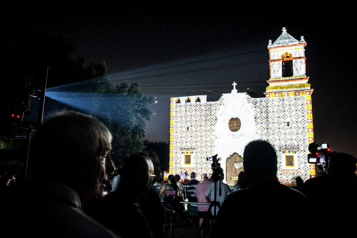 Projections light up Mission San Jose during the