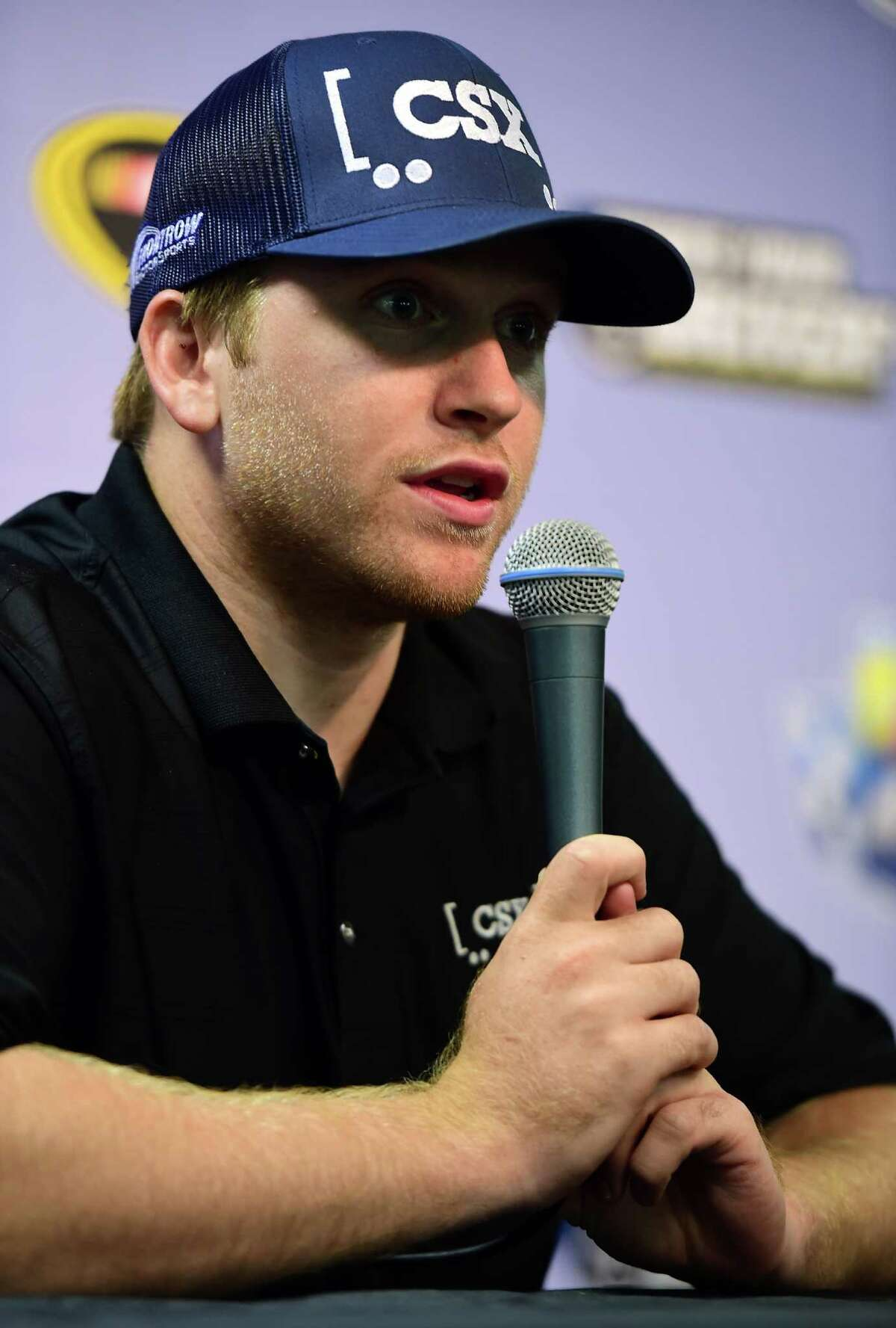 RICHMOND, VA - SEPTEMBER 09: Chris Buescher, driver of the #34 CSX - Play it Safe Ford, speaks with the media after practice for the NASCAR Sprint Cup Series Federated Auto Parts 400 at Richmond International Raceway on September 9, 2016 in Richmond, Virginia. (Photo by Jared C. Tilton/Getty Images) ORG XMIT: 595734743