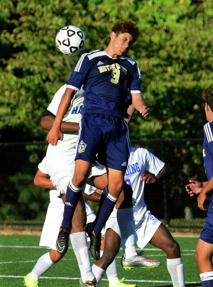 Notre Dame of Fairfield's Felipe Canzian heads the ball, during high school soccer action against Harding at Veteran's Park in Bridgeport, Conn. on Wednesday Sept. 23, 2015. Photo: Christian Abraham / Hearst Connecticut Media / Connecticut Post