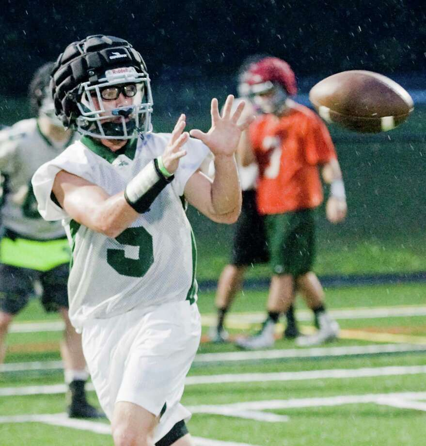 Max Vaughey works on receiving a pass during a New Milford High School football practice. Sunday, Aug. 21, 2016 Photo: Scott Mullin / For Hearst Connecticut Media / The News-Times Freelance