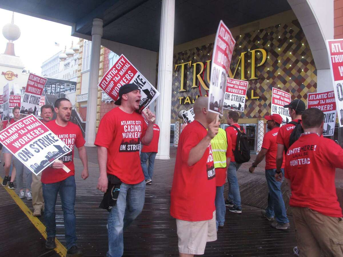 Striking casino workers picket in July at the Trump Taj Mahal casino in Atlantic City, N.J. Management is asking regulators for permission to shut it down.