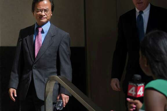 James Robert Liang, 62, of Newbury Park, Calif., leaves federal court in Detroit on Friday. He could receive up to five years in prison and a $250,000 fine. Liang has agreed to cooperate in the widening criminal investigation.