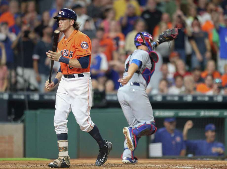 Houston Astros left fielder Colby Rasmus (28) is called out as Chicago Cubs catcher David Ross (3) head for the dugout during an MLB game at Minute Maid Park, Friday, Sept. 9, 2016 in Houston. Photo: Steve Gonzales, Houston Chronicle / © 2016 Houston Chronicle