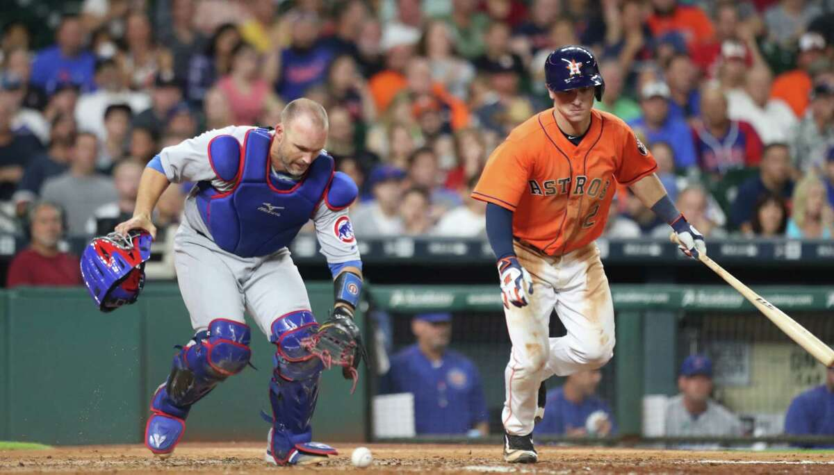 Chicago Cubs catcher David Ross (3) filed a ball infant of Houston Astros third baseman Alex Bregman (2) during an MLB game at Minute Maid Park, Friday, Sept. 9, 2016 in Houston.