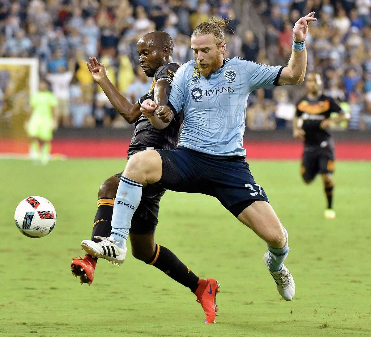 Sporting Kansas City forward Jacob Peterson and Houston Dynamo midfielder DaMarcus Beasley, left, battle for control of the ball in the second half of a 3-3 draw on Friday, Sept. 9, 2016, at Children's Mercy Park in Kansas City, Kan.