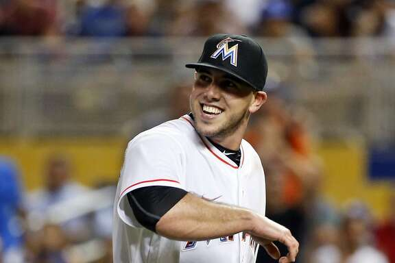 Miami Marlins starting pitcher Jose Fernandez smiles as he leaves the mound after striking out Los Angeles Dodgers' Yasiel Puig to end the seventh inning of a baseball game, Friday, Sept. 9, 2016, in Miami. (AP Photo/Wilfredo Lee)