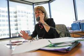 Kate Mitchell, a partner at Scale Venture Partners, talks with a potential client on the phone at her office in Foster City, California, on Friday, Aug. 21, 2015. A recent study found that out of more than 800 venture capital firms in the U.S. less than a third of them employ any female venture capitalists whatsoever. Scale Venture Partners has six female venture capitalists, more then most in the U.S. It tied for third place in the nation with a handful of other firms.