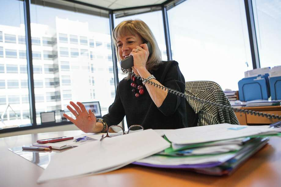Kate Mitchell, a partner at Scale Venture Partners, talks with a potential client on the phone at her office in Foster City, California, on Friday, Aug. 21, 2015. A recent study found that out of more than 800 venture capital firms in the U.S. less than a third of them employ any female venture capitalists whatsoever. Scale Venture Partners has six female venture capitalists, more then most in the U.S. It tied for third place in the nation with a handful of other firms. Photo: Gabrielle Lurie, Special To The Chronicle