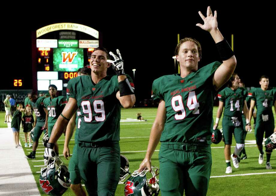 The Woodlands defensive lineman Michael Purcell (99) and John Haldane (94) celebrate after defeating Katy 26-3 during a non-district high school football game Friday, Sept. 9, 2016, at Woodforest Bank Stadium in Shenandoah. Photo: Jason Fochtman / Houston Chronicle