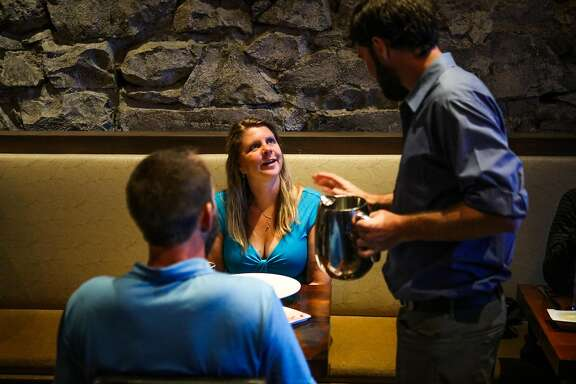 Janicke Stramer-Smith (center) chats with a waiter while dining at Trokay restaurant in Truckee, California, on Friday, Sept. 2, 2016.