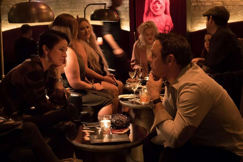 People have drinks at the Black Cat in San Francisco. Photo: John Storey / Special To The Chronicle