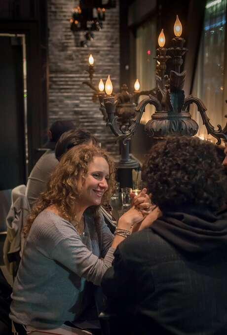 People have drinks at the Black Cat, a sleek and sexy spot at Leavenworth and Eddy streets in the Tenderloin. Photo: John Storey, Special To The Chronicle