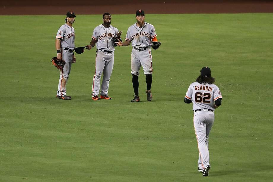 The reactions of Denard Span and Hunter Pence when they saw Cory Gearrin running to the outfield Friday night is priceless. Photo: Christian Petersen, Getty Images