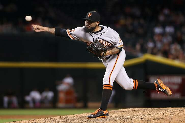 PHOENIX, AZ - SEPTEMBER 09:  Relief pitcher Sergio Romo #54 of the San Francisco Giants throws a pitch during the eighth inning of the MLB game against the Arizona Diamondbacks at Chase Field on September 9, 2016 in Phoenix, Arizona.  (Photo by Christian Petersen/Getty Images)