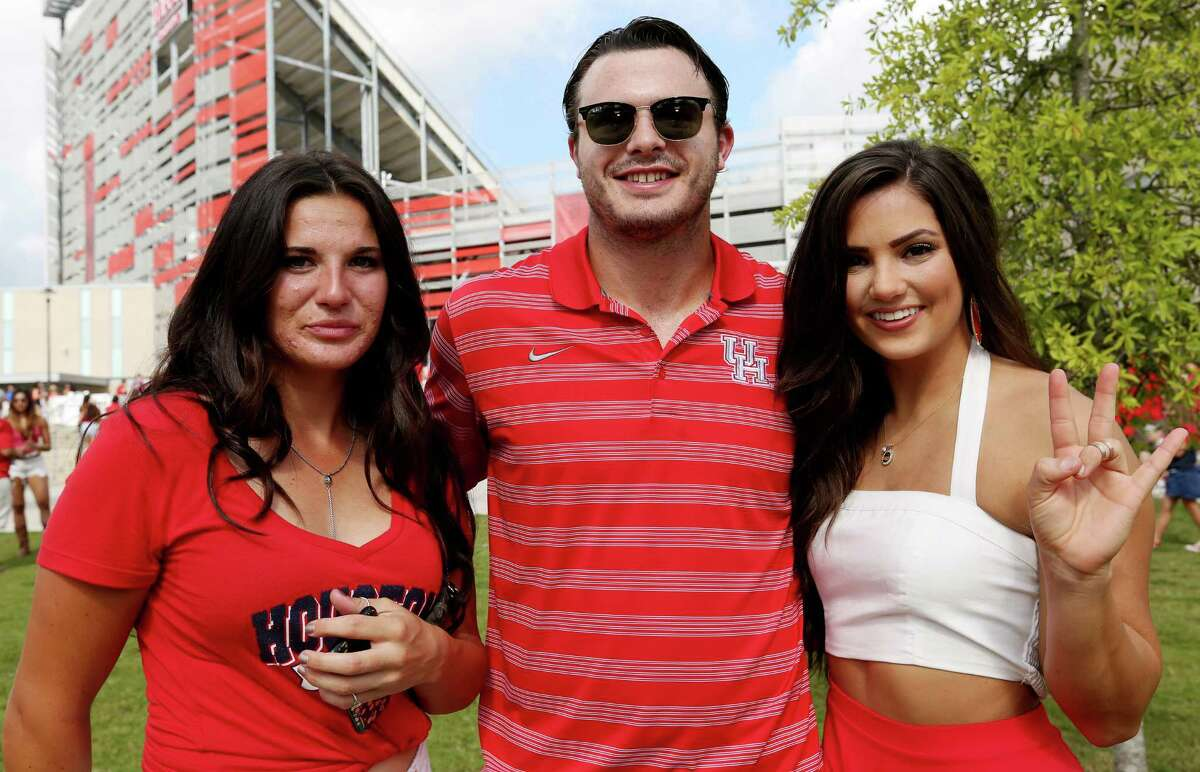 Fans pose for a photo before University of Houston takes on Lamar University for the American Athletic Conference game at TDECU Stadium Saturday, Sept. 10, 2016, in Houston.