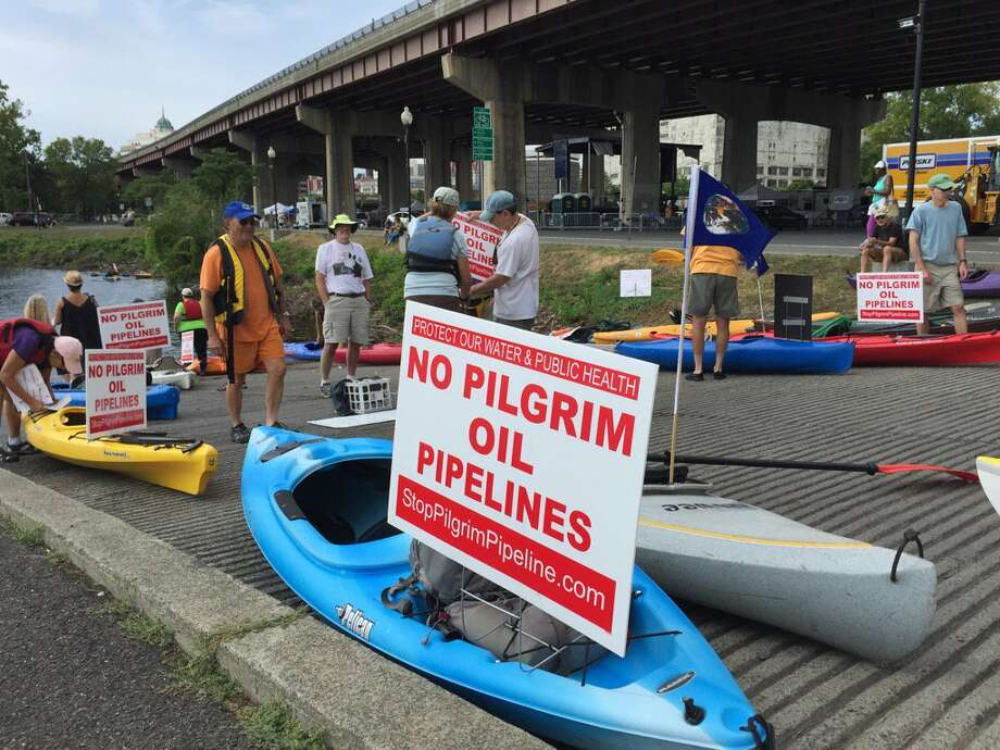 More than 50 environmental activists paddled kayaks and canoes Saturday in the People Over Pipelines Flotilla to protest a proposed Pilgrim oil pipelines project that would run under the Hudson River between the ports of Albany and Rensselaer and 170 miles along the state Thruway to refineries in New Jersey (Paul Grondahl /Times Union)