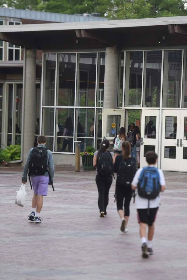 Students walk through the courtyard and in the front doors before the start of the school day at Greenwich High School in Greenwich, Conn. Thursday, June 4, 2015. High school classes currently begin at 7:30 a.m. The Board of Education is discussing instituting later start times at Greenwich schools. Photo: Tyler Sizemore / Tyler Sizemore / Greenwich Time
