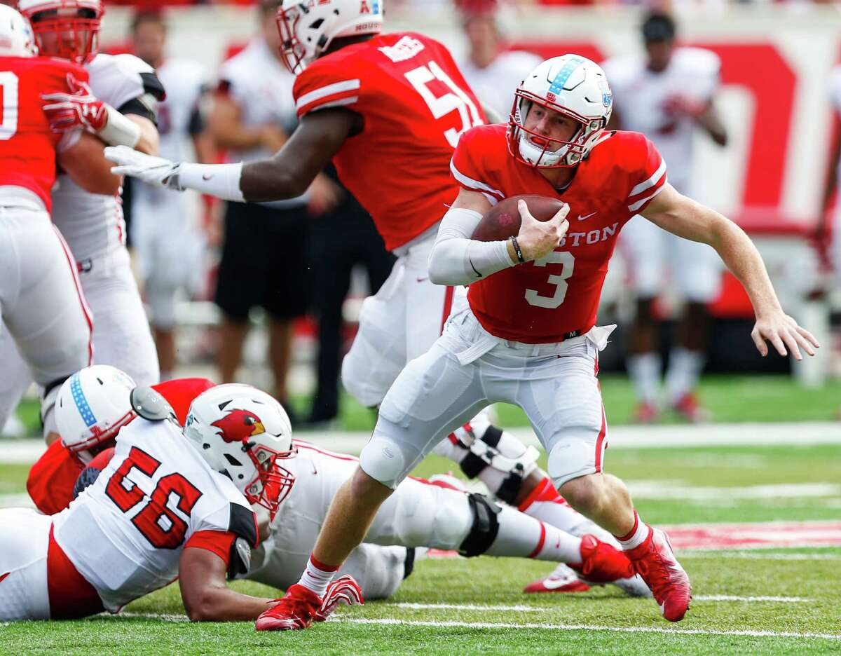 Houston quarterback Kyle Postma (3) cuts away from Lamar defensive end Manasseh Miles (56) as he scrambles out of the pocket during the first quarter of an NCAA football game at TDECU Stadium on Saturday, Sept. 10, 2016, in Houston.
