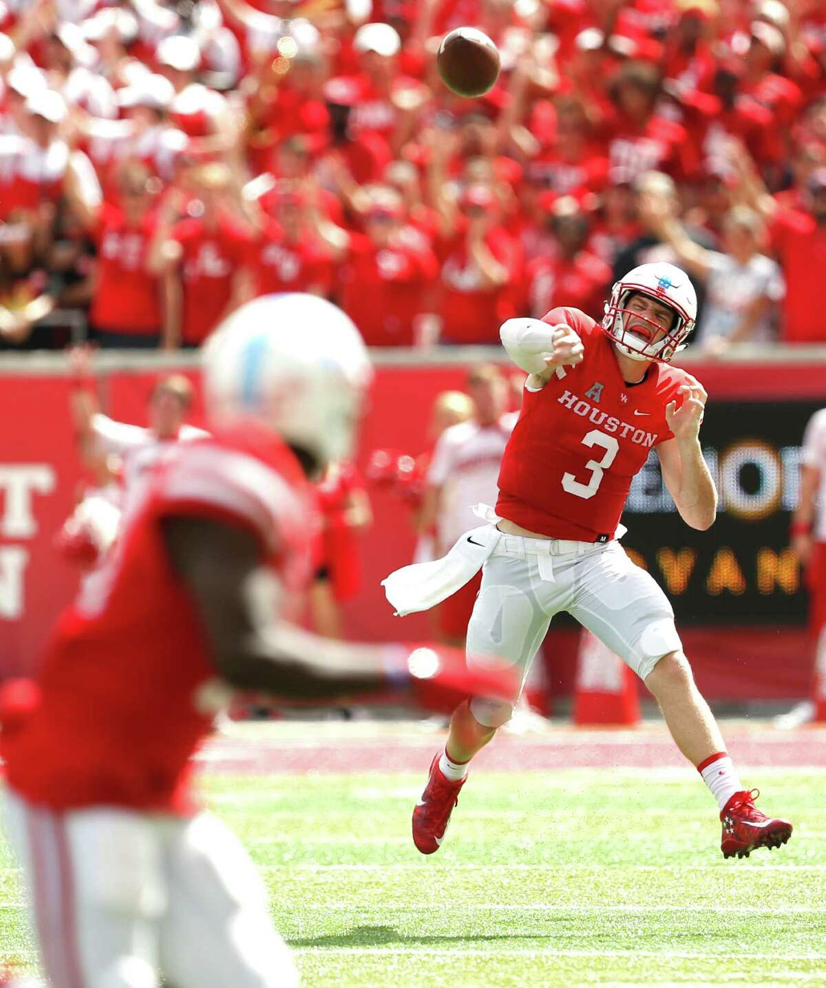 Houston quarterback Kyle Postma (3) throws a pass to wide receiver Linell Bonner (15) during the first quarter of an NCAA football game against Lamar at TDECU Stadium on Saturday, Sept. 10, 2016, in Houston.