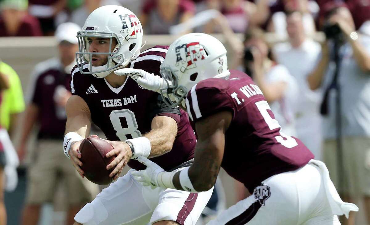 Texas A&M quarterback Trevor Knight (8) fakes a hand off to teammate Trayveon Williams (5) during an NCAA college football game against Prairie View A&M, Saturday, Sept. 10, 2016, in College Station, Texas. (AP Photo/Sam Craft)