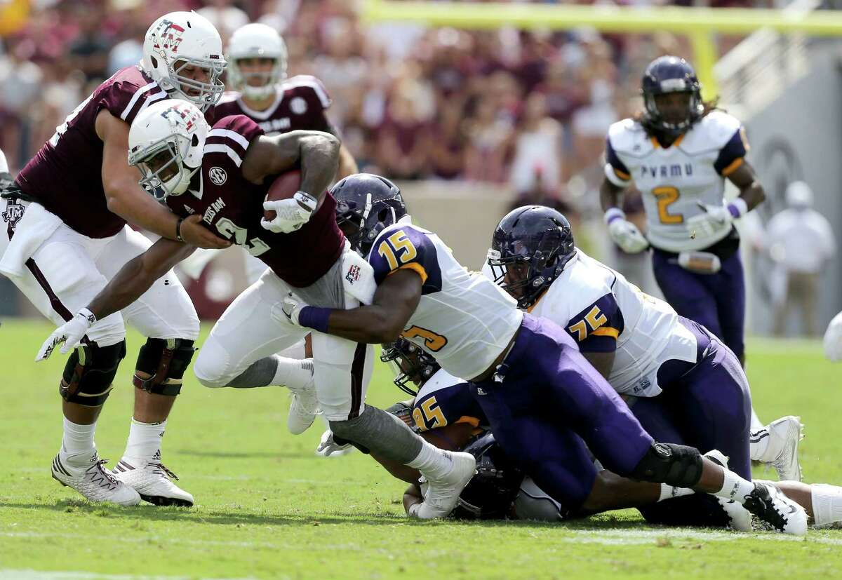 Texas A&M wide receiver Speedy Noil (2) is tackled by Prairie View A&M linebacker Jamespaul Bryant (15) after a catch during the first half of an NCAA college football game Saturday, Sept. 10, 2016, in College Station, Texas. (AP Photo/Sam Craft)
