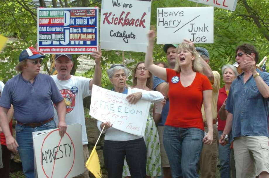 Mary Babinski, second from the right, from North Branford, and others lined up on Meadow Lane in Greenwich, to protest Sen. Joseph Lieberman's fundraiser for Sen. Harry Reid, D-Nev., on Sunday, May 2, 2010. Photo: Helen Neafsey / Greenwich Time
