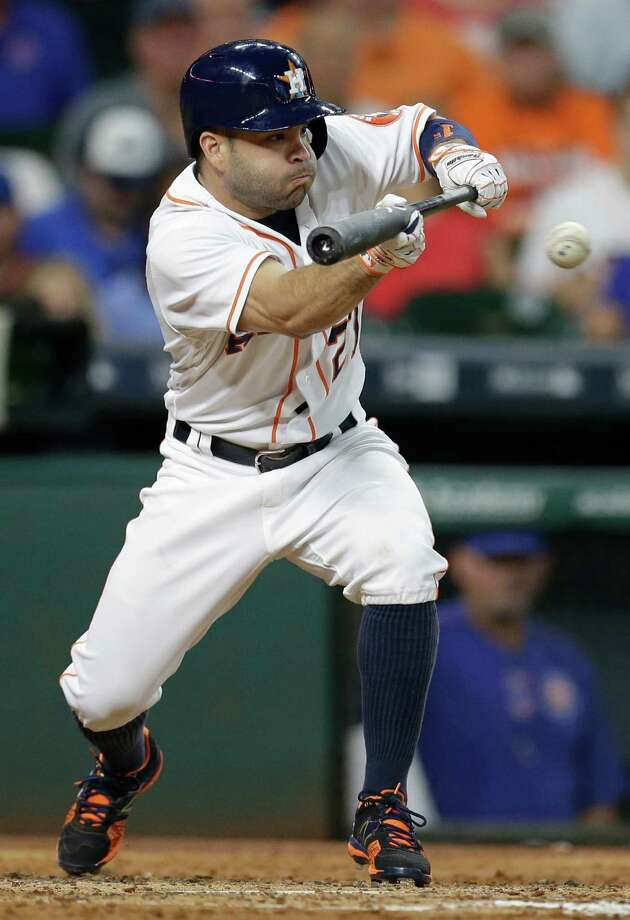 Houston Astros Jose Altuve singles on a bunt against the Chicago Cubs during the third inning at Minute Maid Park Saturday, Sept. 10, 2016, in Houston. Photo: Melissa Phillip, Houston Chronicle / © 2016 Houston Chronicle