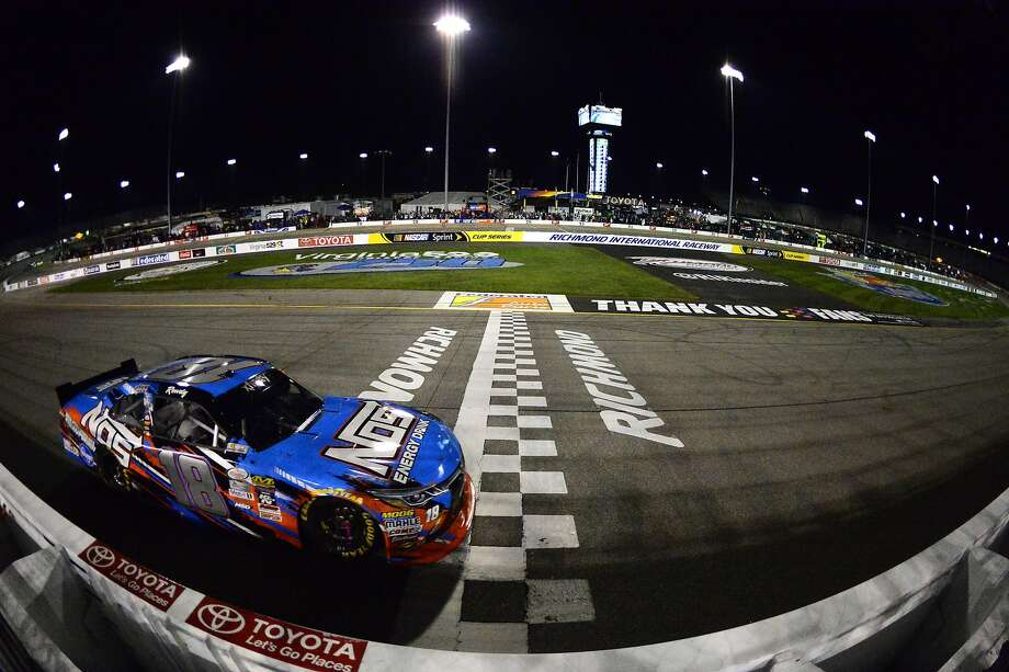 Kyle Busch crosses the finish line to win the NASCAR Xfinity Series 250-mile at Richmond International Raceway on Friday. Photo: Robert Laberge, Getty Images