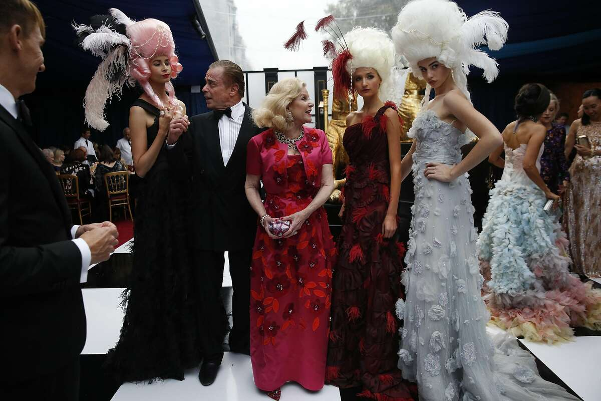 Boaz Mazor and Dede Wilsey pose with models during the Opera Ball, celebrating the opening night of the San Francisco Opera Sept. 9, 2016 in San Francisco, Calif.