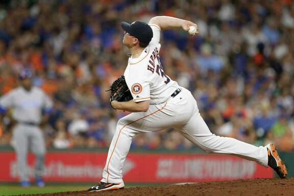 Houston Astros Will Harris pitches against the Chicago Cubs during the seventh inning at Minute Maid Park Saturday, Sept. 10, 2016, in Houston.