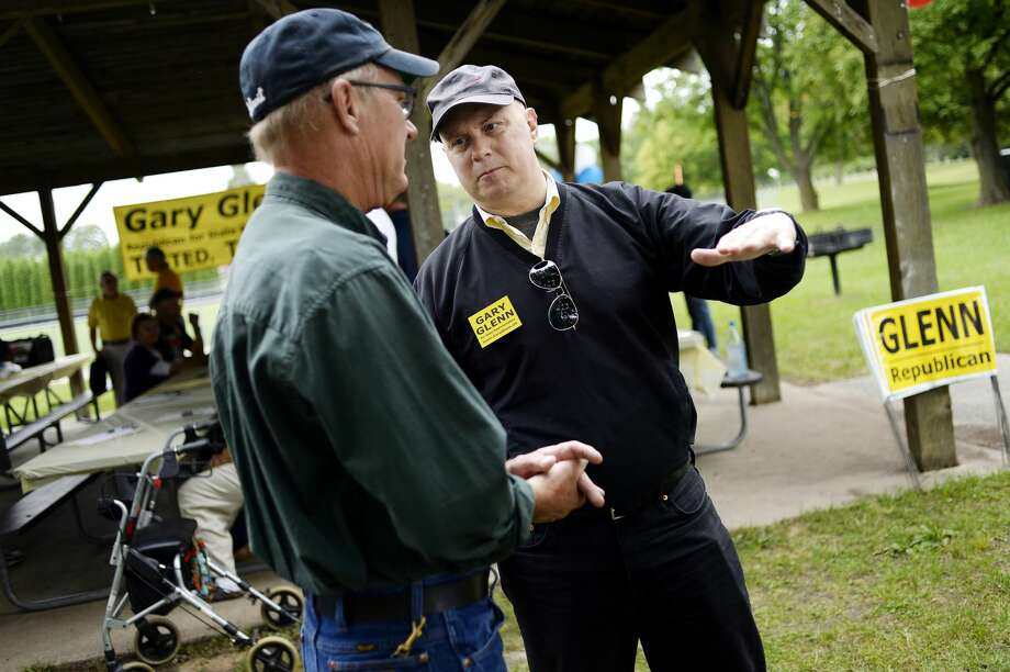 NICK KING | nking@mdn.net  State Rep. Gary Glenn, R-Midland, right, talks with Bay County drain commissioner candidate Nelson Niederer during a party to announce Glenn's intention to seek reelection on Saturday at Plymouth Park. Photo: Nick King/Midland Daily News