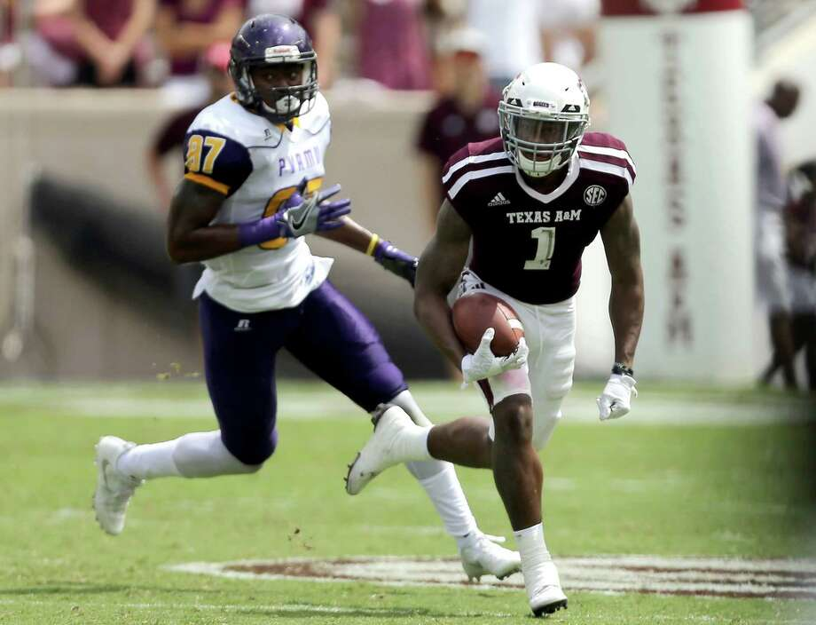 Texas A&M's Nick Harvey (1) breaks away from Prairie View A&M wide receiver Demarquo Lastrappe (87) for a 73 yard punt return for a touchdown during the second half of an NCAA college football game Saturday, Sept. 10, 2016, in College Station, Texas. (AP Photo/Sam Craft) Photo: Sam Craft, Associated Press / AP