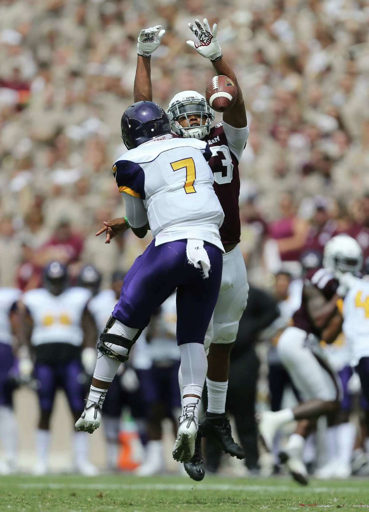 Texas A&M defensive lineman Reggie Chevis (13) knocks a pass attempt by Prairie View A&M quarterback Trey Green (7) during the second half of an NCAA college football game Saturday, Sept. 10, 2016, in College Station, Texas. (AP Photo/Sam Craft)