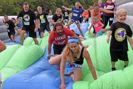 Runners of all ages compete in the Insane Inflatable 5K at Ellms Family Farm on Saturday Sept. 10, 2016 in Ballston Spa, N.Y. (Michael P. Farrell/Times Union)
