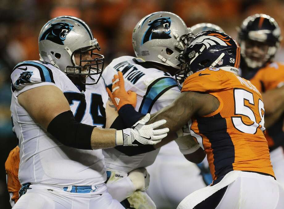 Panthers quarterback Cam Newton takes a helmet-to-helmet his by Broncos outside linebacker Von Miller during the second half of the NFL's season opener Thursday night. Photo: Joe Mahoney, Associated Press