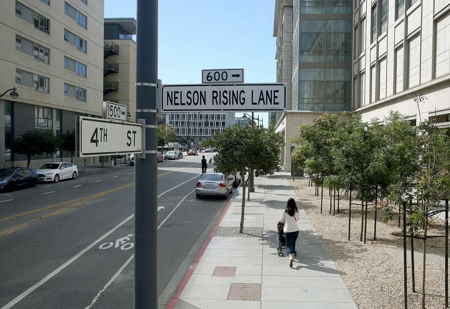 View of Nelson Rising Lane street sign at 4th Street on Friday, September 2, 2016, in San Francisco, Calif.  CEO Nelson Rising of Catellus Development Corporation  brought Mission Bay back to life during the mid nineties during his tenure and was instrumental in luring UCSF to the area. Photo: Liz Hafalia/The Chronicle