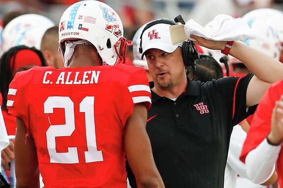 Houston head coach Tom Herman talks to wide receiver Chance Allen (21) as he comes off the field during the second quarter of an NCAA football game against Lamar  at TDECU Stadium on Saturday, Sept. 10, 2016, in Houston.