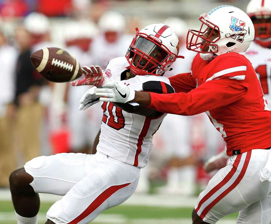 Lamar defensive back Rodney Randle (20) breaks up a pass intended for Houston wide receiver Isaiah Johnson (14) during the second quarter of an NCAA football game at TDECU Stadium on Saturday, Sept. 10, 2016, in Houston. Photo: Brett Coomer, Houston Chronicle / © 2016 Houston Chronicle