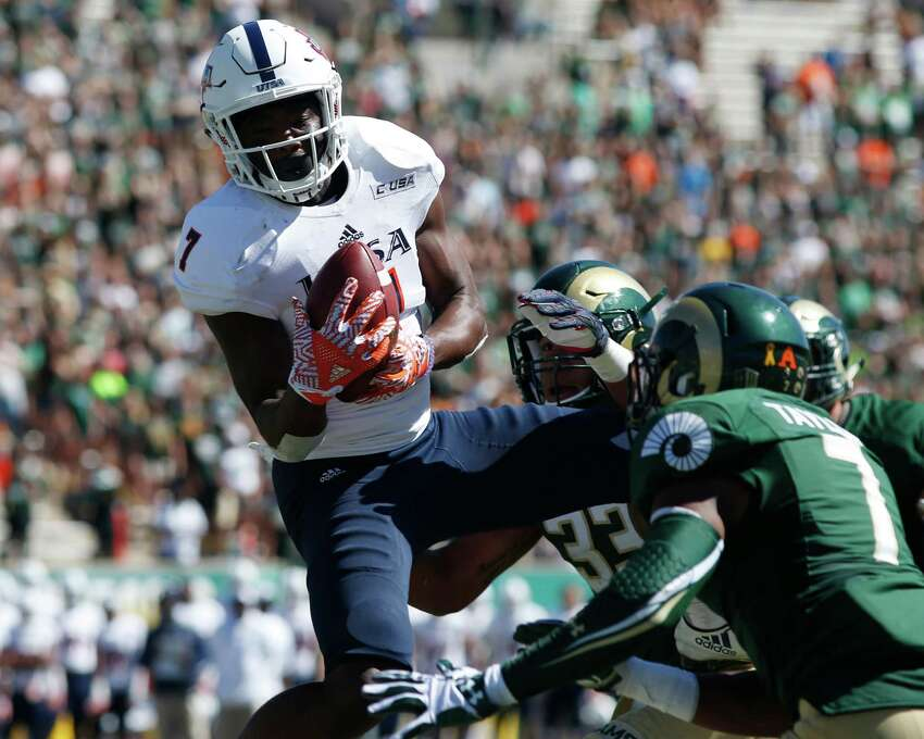 UTSA running back Jalen Rhodes, front, is dragged down by Colorado State linebacker Josh Watson after pulling in a pass in the second half of an NCAA college football game Saturday, Sept. 10, 2016, in Fort Collins, Colo. (AP Photo/David Zalubowski)