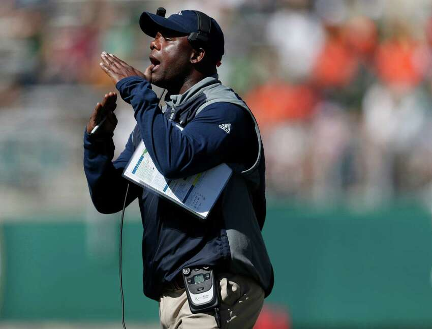 UTSA head coach Frank Wilson calls for a timeout in the first half of an NCAA college football game against Colorado State, Saturday, Sept. 10, 2016, in Fort Collins, Colo. (AP Photo/David Zalubowski)