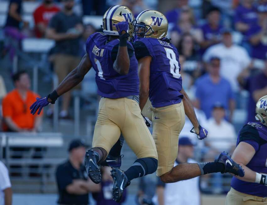 Wide receiver Dante Pettis #8 (R) of the Washington Huskies celebrates with wide receiver John Ross #1 after scoring a touchdown against the Idaho Vandals on September 10, 2016 at Husky Stadium in Seattle, Washington. (Photo by Otto Greule Jr/Getty Images)