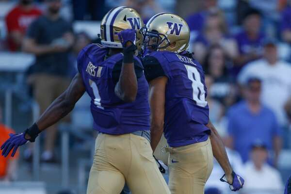 SEATTLE, WA - SEPTEMBER 10:  Wide receiver Dante Pettis #8 (R) of the Washington Huskies celebrates with wide receiver John Ross #1 after scoring a touchdown against the Idaho Vandals on September 10, 2016 at Husky Stadium in Seattle, Washington.  (Photo by Otto Greule Jr/Getty Images)