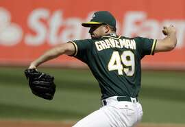 Oakland Athletics starting pitcher Kendall Graveman throws to the Seattle Mariners during the second inning of a baseball game, Saturday, Sept. 10, 2016, in Oakland, Calif. (AP Photo/Marcio Jose Sanchez)