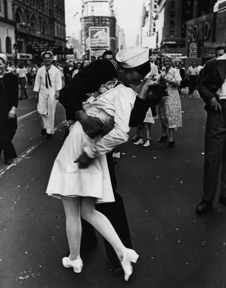 In the United States and many other countries, it's traditional to count down from 10 to 1 and then lock lips with a loved one, friend or stranger you just met. Though this famous scene at the end of World War II wasn't on New Year's Eve, you get the idea. (AP Photo/copyright-Alfred Eisenstaedt/Life Magazine) Photo: ALFRED EISENSTAEDT, Associated Press